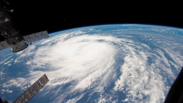 Hurricane Katia is seen from a window of the International Space Station in this NASA on August 31, 2011. In six experiments, people more inclined to flee a storm with a male name than a similar female name.
