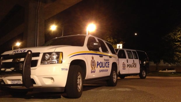 Transit Police vehicles are seen parked outside the Nanaimo SkyTrain Station May 17, 2014, after officers responded to a report of a stabbing on a train.