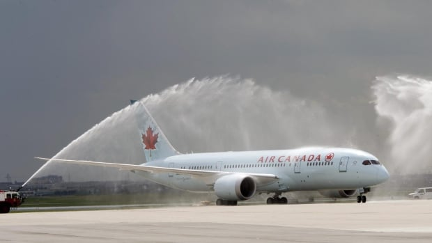An Air Canada-owned Dreamliner was greeted with a water cannon salute after landing at Pearson airport on Sunday.