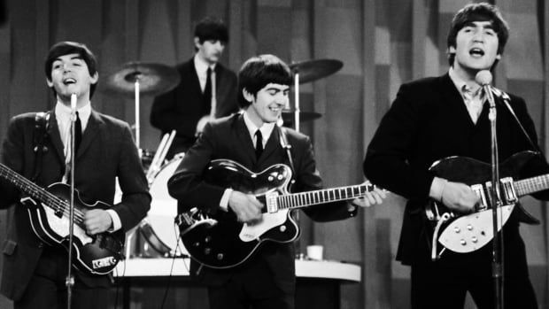 "The Beatles, from left, Paul McCartney, Ringo Starr on drums, George Harrison and John Lennon, perform for the CBS ""Ed Sullivan Show"" in New York in 1964. One of Harrison's guitars (not shown) was auctioned off Saturday."