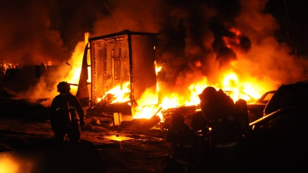 Firefighters battled flames at the repair shop for several hours Tuesday morning.