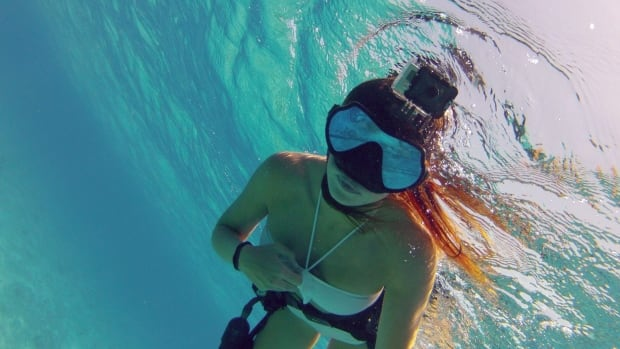 This undated photo provided by GoPro shows  the GoPro in dive housing.  GoPro Inc., which makes a small line of high-definition video cameras geared toward extreme sports athletes, is experiencing a rare moment in the spotlight. The San Mateo, Calif.-based company is a common sight at the Winter Olympics in Sochi, Russia, showing up in everything from the opening ceremony to test runs of ski and snowboarding courses. ( AP Photo/GoPro)