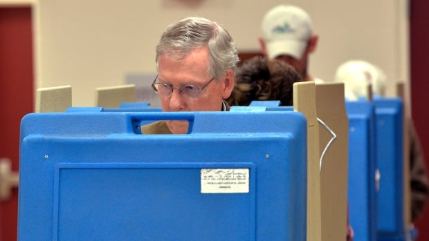 Kentucky Senator Mitch McConnell fills out his ballot for Kentucky's mid term primaries on Tuesday in Louisville, Ky. Ten months and $12 million later, Kentucky Republicans will put an end the fight between  McConnell and Matt Bevin. McConnell is expected to easily defeat his Tea Party opponent.