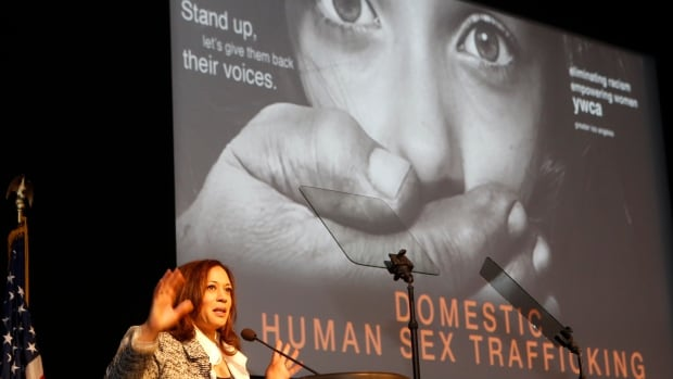 California Attorney General Kamala Harris addresses the Domestic Human Trafficking symposium in Los Angeles on April 25, Trafficking, forced labour and modern slavery are big business, generating profits estimated at $150 billion a year, the UN labour agency said Tuesday. Damian Dovarganes/Associated Press file photo)
