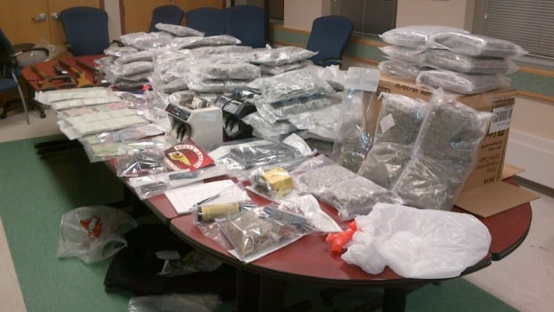RCMP display some of the drugs, weapons and other items that were seized from a home in the Rural Municipality of St. Clements on May 17.