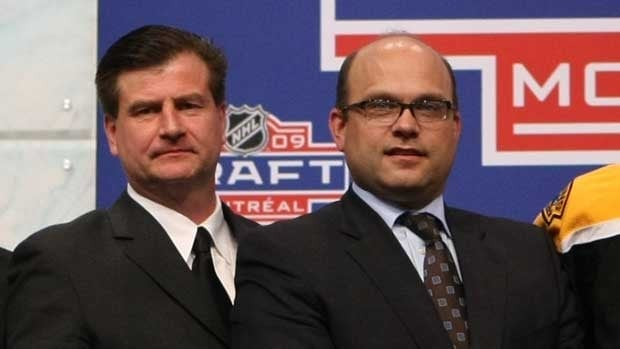 Jim Benning, left, is seen with Boston general manager Peter Chiarelli at the 2009 NHL Entry Draft.