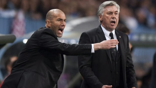 Zinedine Zidane, left, is seen assisting Real Madrid coach Carlo Ancelotti in a January match.