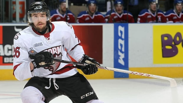 Guelph Storm defenceman/forward Chadd Bauman will sit out Sunday's Memorial Cup final in London, Ont., after he was suspended for the balance of the tournament for a knee-on-knee hit against Val-d'Or Foreurs blue-liner Guillaume Gelinas.