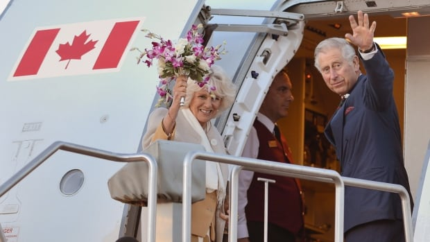 Camilla, Duchess of Cornwall (left) and Prince Charles wave as they leave Winnipeg on Wednesday evening.