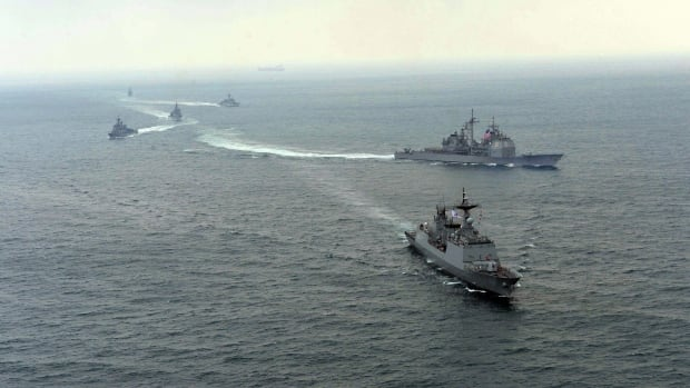 South Korea and U.S. warships participate in their joint military drill earlier this month. North Korean and South Korean ships exchanged artillery fire Thursday but did no damage.