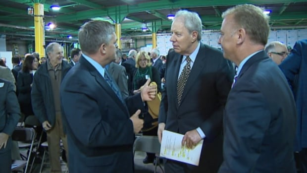 Premier David Alward, Jim Irving and Natural Resources Minister Paul Robichaud appeared at a news conference in Chipman earlier this year. A poll commissioned by J.D. Irving Ltd. shows support for the Alward government's Crown forest agreement.