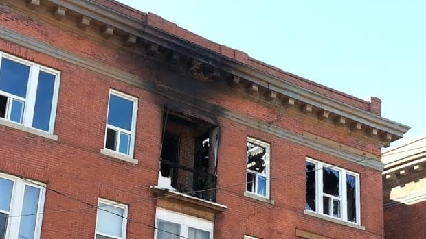 The outside of a south Osborne building is scorched from a fire that forced all residents out on Wednesday afternoon. As of Thursday, no one has been allowed to return.