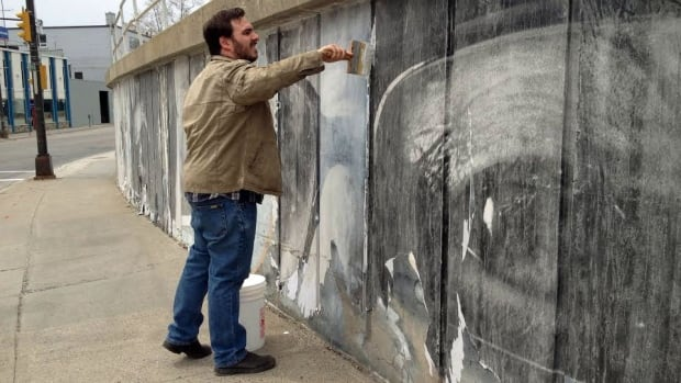 Christian Pelletier says the murals put up by the We Live Up Here group took a beating over the winter. They will attempt to repair the murals and seal them with a product that is touted to withstand the elements — even those of a long Sudbury winter.