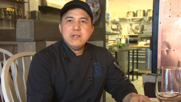 A federal moratorium on temporary foreign workers means Zacharias Manuel, who has been working at a St. John's restaurant for the past year, may have to leave the country.