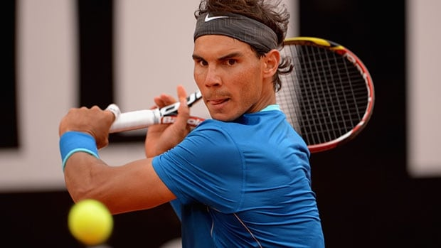 ROME, ITALY - MAY 15: Rafael Nadal of Spain in action against Mikhail Youzhny of Russia during day 5 of the Internazionali BNL d'Italia 2014 on May 15, 2014 in Rome, Italy. (Photo by Michael Regan/Getty Images)