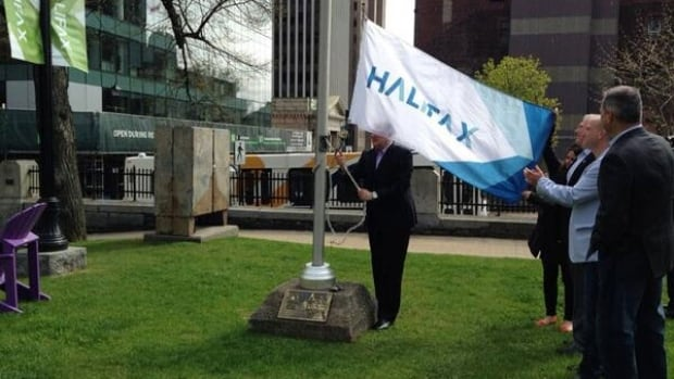 Mike Savage raises the new flag.