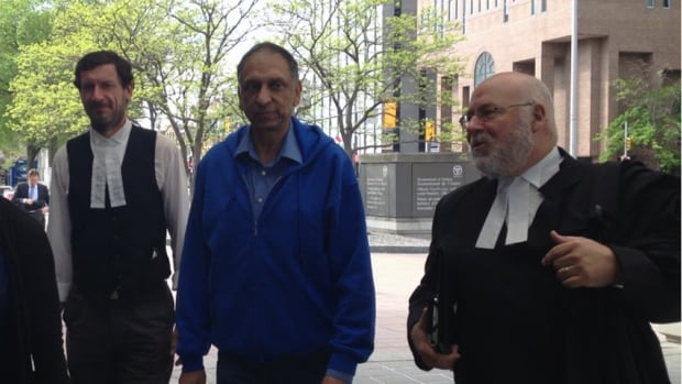 Nazir Karigar, centre, an Ottawa-area businessman, received a three-year sentence today for his role in a bribery scheme involving Air India.