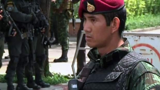 Thailand coup leaders hold former PM