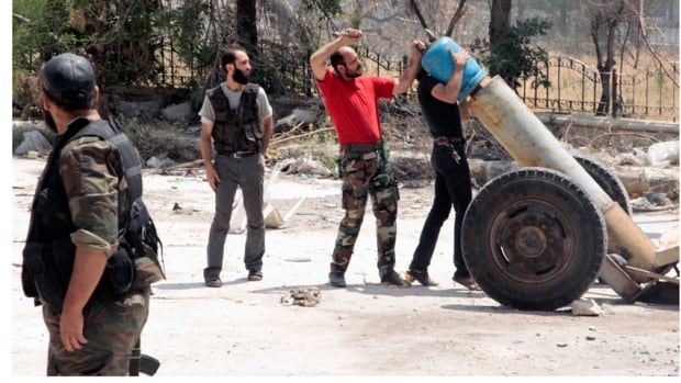 Free Syrian Army fighters often use improvised weapons like this mortar in their battle against forces loyal to President Bashar al-Assad.