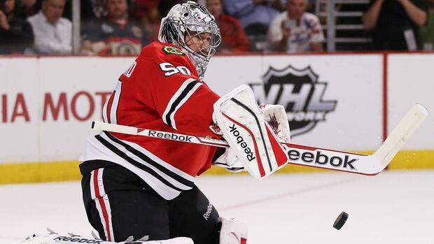 Corey Crawford of the Blackhawks makes a stick save in a 6-2 loss to the Kings in Game 2 at Staples Center on May 21.