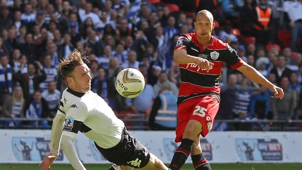 Queens Park Rangers' Bobby Zamora, right, scores his side's  goal during the English Championship Play Off finial against Derby County at Wembley Stadium, London.