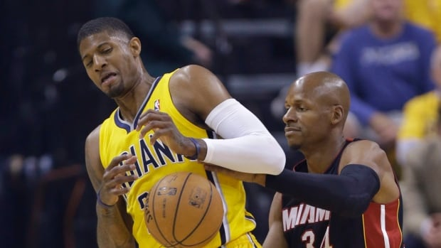 Indiana Pacers' Paul George, left, is defended by Miami Heat's Ray Allen during the first half of Game 2, before his injury.