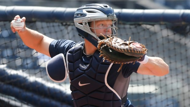 San Diego Padres catcher Nick Hundley makes a throw to second during pregame warmups where the Padres' catchers all worked on their throwing before a baseball game against the Detroit Tigers Saturday, April 12, 2014, in San Diego. (AP Photo/Lenny Ignelzi)