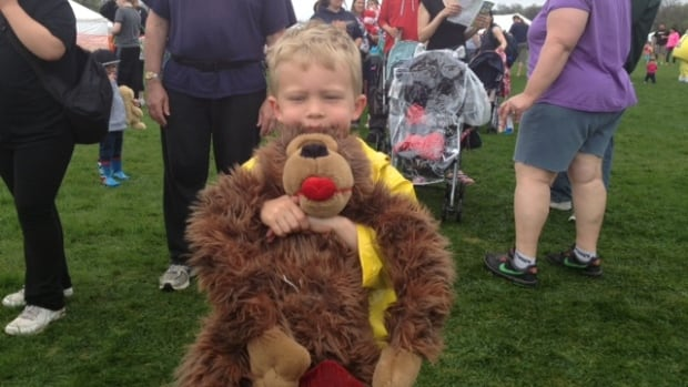 Cadel Cheop, 5, brought his monkey, Stuffy, to get his head patched up at the