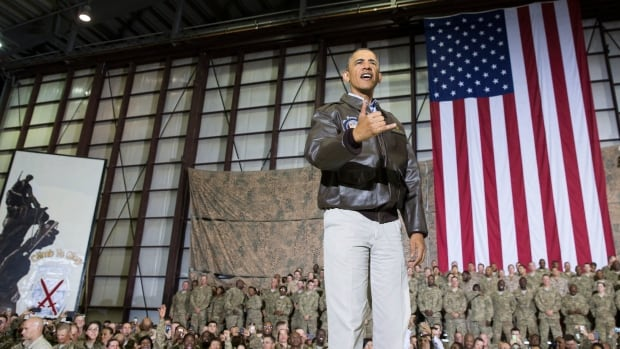 President Barack Obama greets troops at a rally at Bagram Air Field during an unannounced visit.