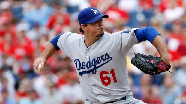 Los Angeles Dodgers right-hander Josh Beckett pitches during the second inning on Sunday in Philadelphia.