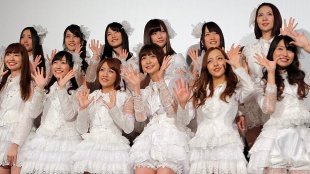 Members of AKB48 pose at the opening premiere of their new film AKB48: No Flower Without Rain in Tokyo in 2013. Two members of the hit, all-female Japanese pop group and a male staffer have been released from hospital after being attacked by a man at a fan event Sunday.