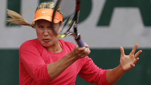 Canada's Eugenie Bouchard plays a shot during her straight-sets win over Israel's Shahar Peer at Roland Garros in Paris.