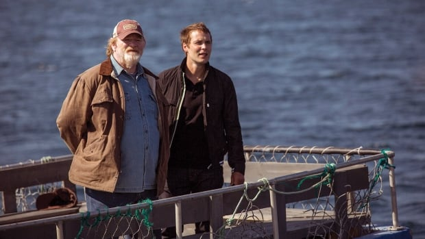 From left, Brendan Gleeson plays Murray French and Taylor Kitsch plays Dr. Paul Lewis in The Grand Seduction. The film opens in theatres May 30.