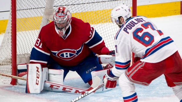 New York Rangers left wing Benoit Pouliot fires the puck at Carey Price during the series opener, shortly before the Canadiens goalie was injured.