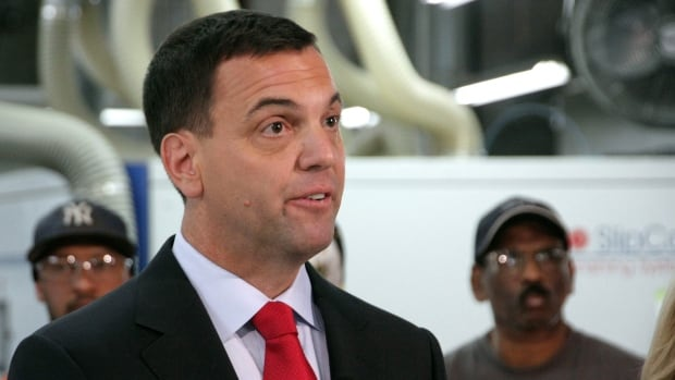 Progressive Conservative Leader Tim Hudak is seen during a campaign stop at a plant in Thornhill, Ont., on May 26, 2014. Hudak wasn't at the Ontario leaders' debate in Thunder Bay.