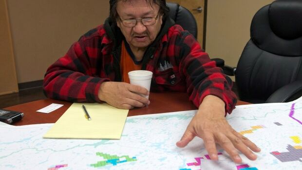 Former Fort Hope First Nation Chief Charlie Okeese looks over the mining claims for the Ring of Fire project on the Fort Hope First Nation in 2012.