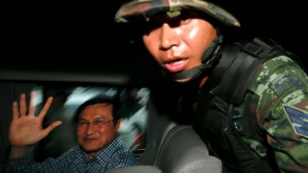 Former Thai Education Minister Chaturon Chaisang, who had been on the run after refusing to turn himself in to the military after being summoned, is surrounded by soldiers and reporters as he is being detained after giving a talk at the Foreign Correspondents' Club of Thailand in Bangkok on Tuesday.