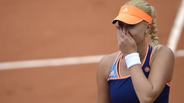 Frenchwoman Kristina Mladenovic reacts after defeating China's Li Na at Roland Garros in Paris.