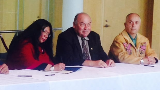Salt River Chief Frieda Martselo signs on to the Northwest Territories' devolution agreement in Yellowknife May 26. Next to her are Premier Bod McLeod and Minister of Finance and Environment and Natural Resources, Michael Miltenberger.
