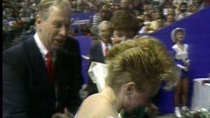 Peter Dunfield congratulates Elizabeth Manley after a skate. He coached Manley when she earned a silver medal at the Calgary Games.