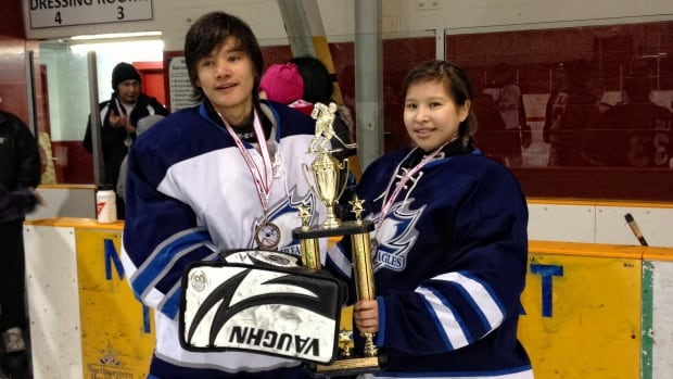 Jenelle Manitowabi, right, and her brother Samuel hold the trophy they won with the Lac Seul Jr. Eagles at the Northern lil'Bands tournament in Sioux Lookout, Ont., this past February.