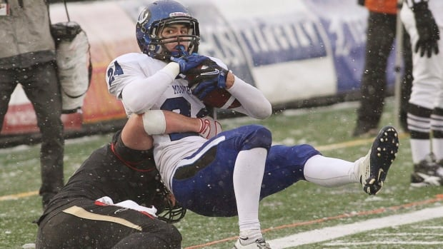 Defensive back Antoine Pruneau, top, had 41 tackles, 3.5 sacks, one interception and two forced fumbles in eight games last season for the CIS's Montreal Carabins.