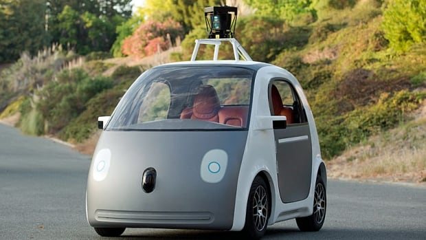 This image provided by Google shows a very early version of Google's prototype self-driving car. The two-seater won't be sold publicly, but Google on Tuesday said it hopes by this time next year, 100 prototypes will be on public roads.