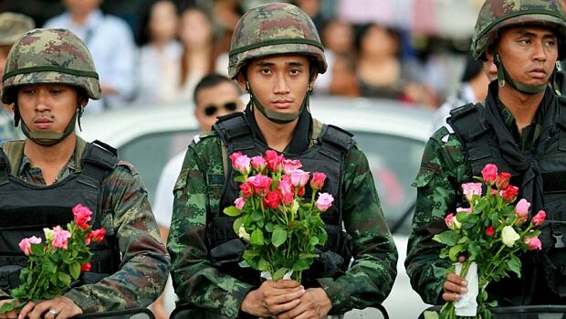 Some Thais protested last week's coup, some brought flowers and cold drinks to the soldiers guarding the area near the Victory Monument in Bangkok, a popular protest site.