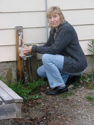 Sonja Rueck pours water from her well.