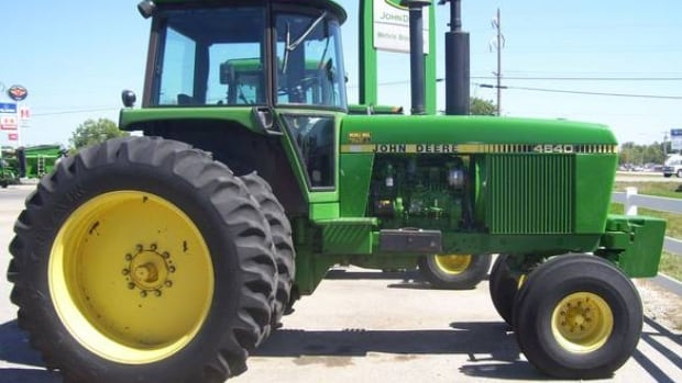 A clerical error led to the sale of a John Deere tractor (like this one) for $1,800. A court has ruled the actual bid - $18,000 - must be paid.