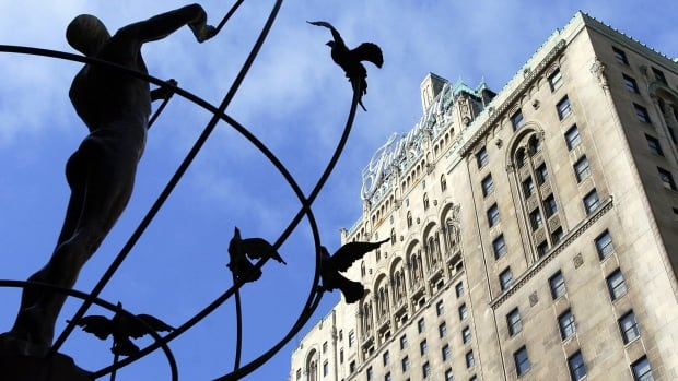 The Fairmont Royal York is seen in Toronto with the statue Monument to Multiculturalism. The Toronto hotel has new owners who plan to put $50 million into renovating it.