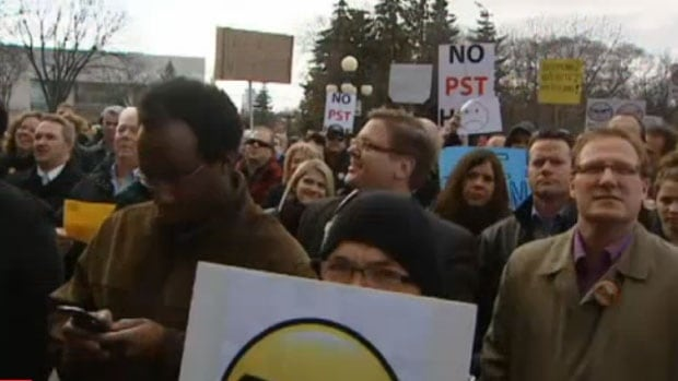 Hundreds of people rallied against the PST hike at the Manitoba Legislature in June 2013.