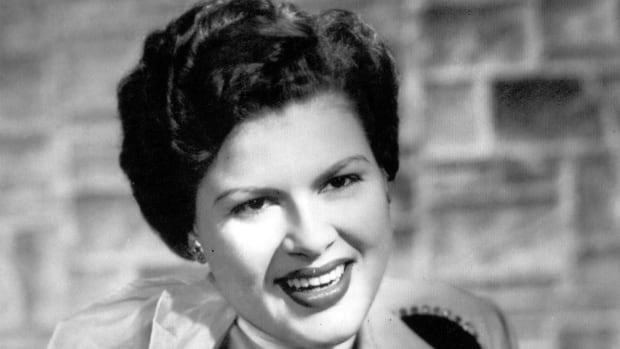 Country singer and recording star, Patsy Cline, is shown in an undated file photo. Forty years after Cline's career was cut short in a plane crash near the marshy banks of the Tennessee River, fans leave plastic flowers and written messages at the crash site.