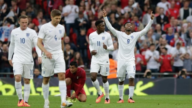 England's Daniel Sturridge, right, celebrates scoring during the international friendly soccer match between England and Peru at Wembley Stadium on Friday.
